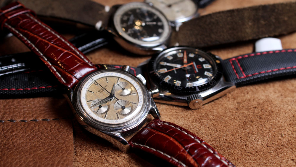 An assortment of vintage Universal Geneve watches.