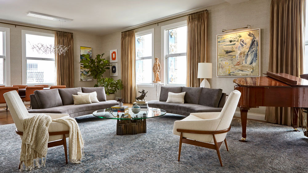 Furnished and layered living room in light colors