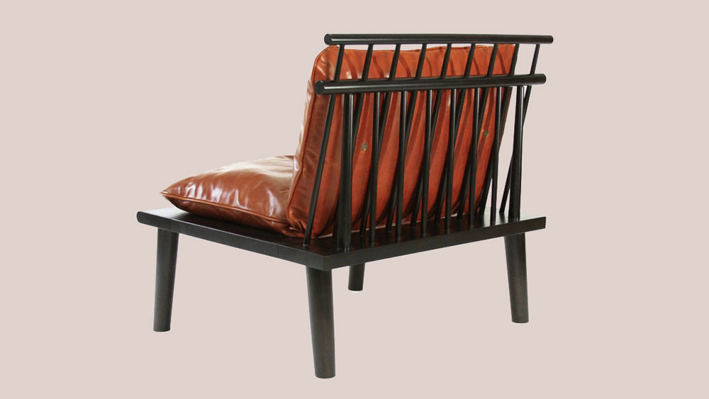Rich cognac leather and wood lounge chair