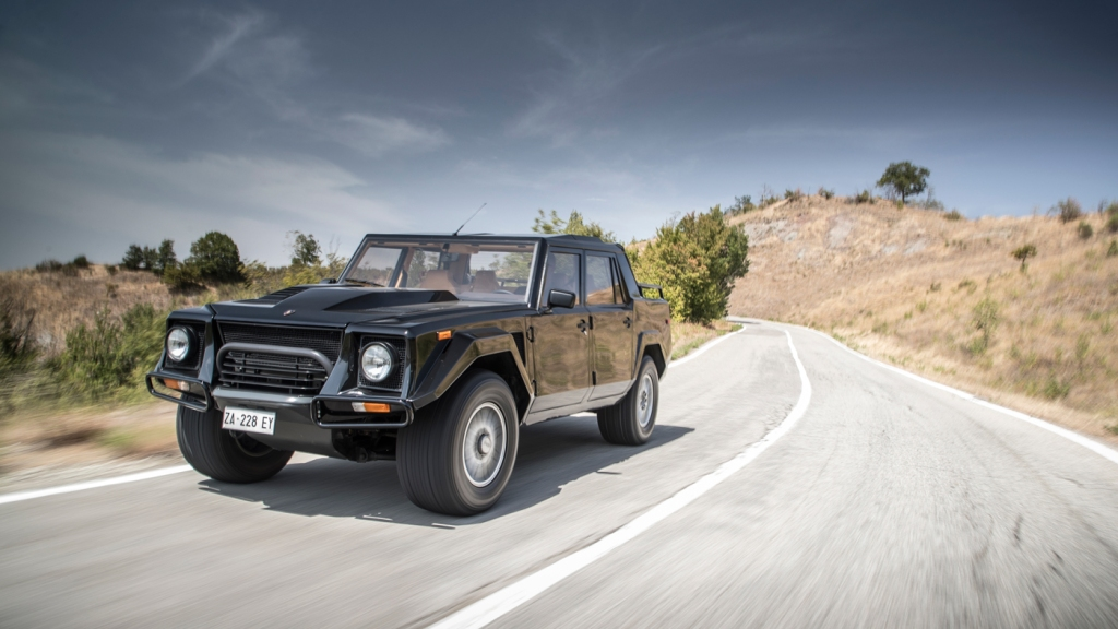 A Lamborghini LM002 driving on the road.
