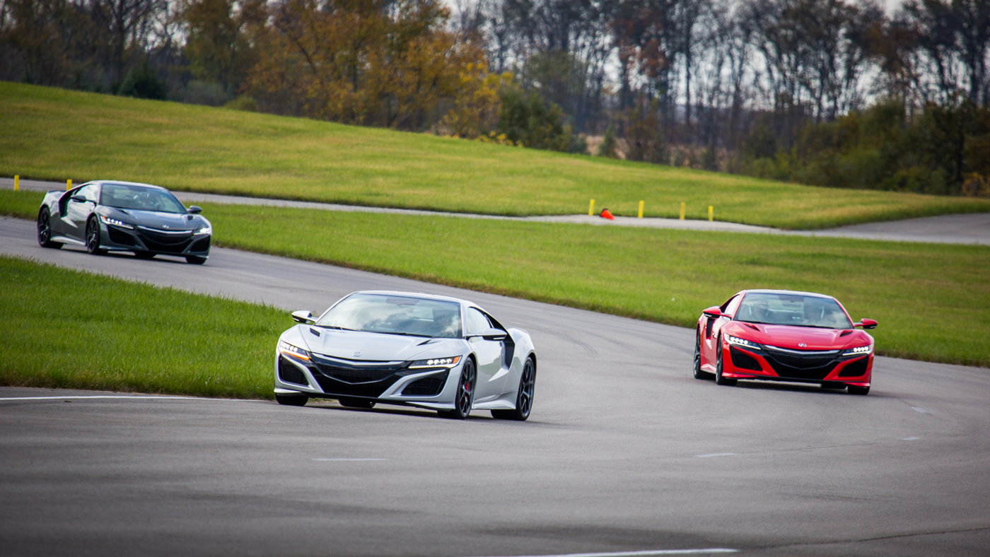 A trio of Acura NSX on the track at the Acura Proving Grounds in Marysville, Ohio.