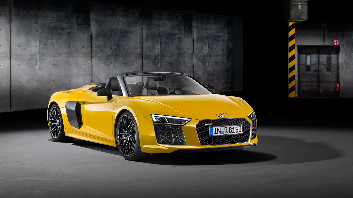 The 540 hp Audi R8 V10 Spyder with 7-speed dual-clutch transmission and Quattro all-wheel drive.