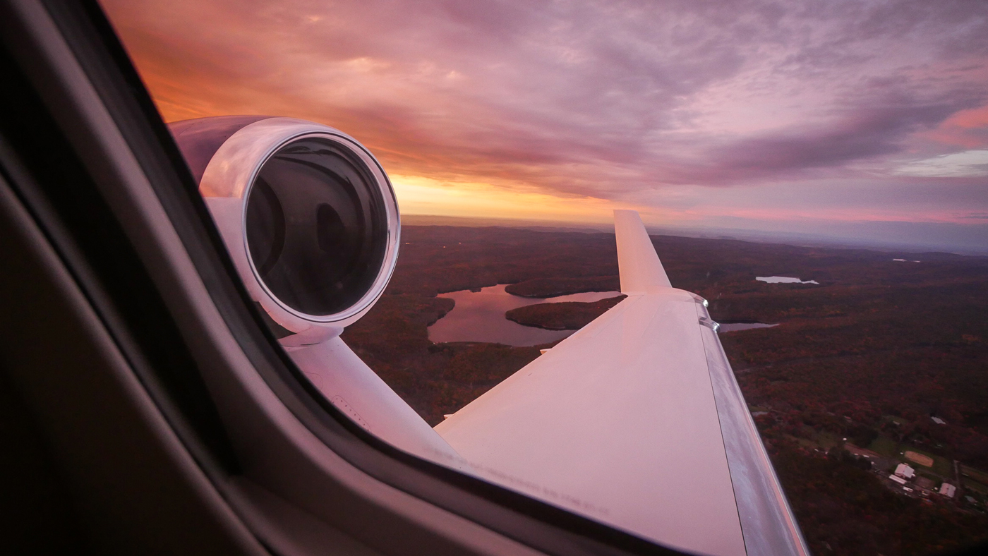 Looking out the window of a HondaJet aircraft.