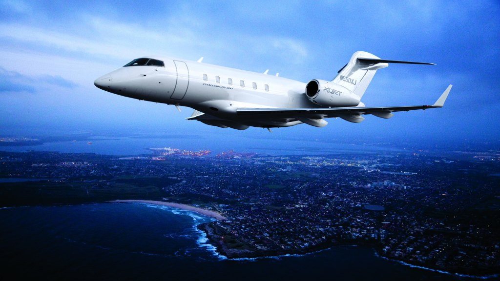 XOJet charter aircraft private travel business jet Bombardier Challenger 300