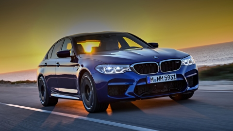The 2018 BMW M5 by the ocean.
