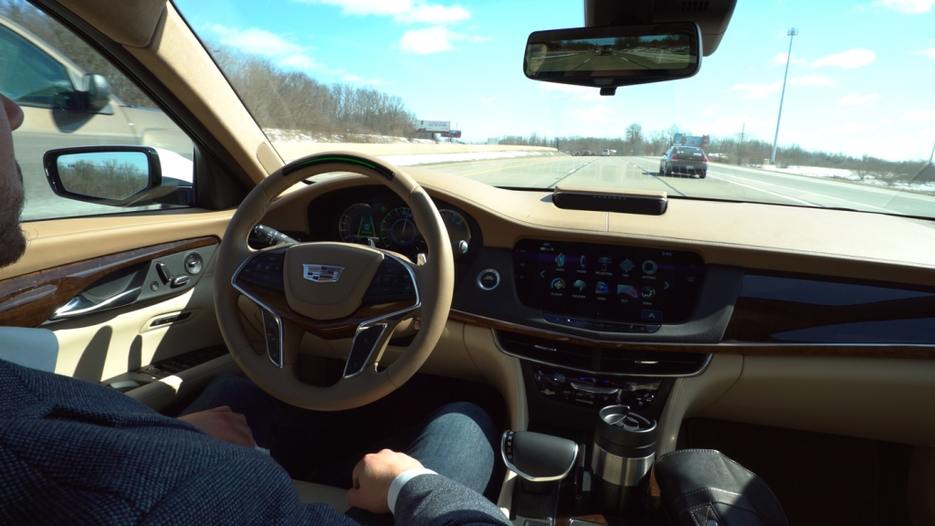 A driver employing Cadillac's Super Cruise feature in a CT6 sedan.