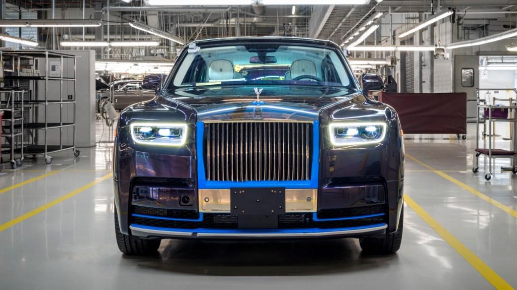 A Rolls-Royce Phantom VIII in Belladonna Purple with an Arctic White interior.