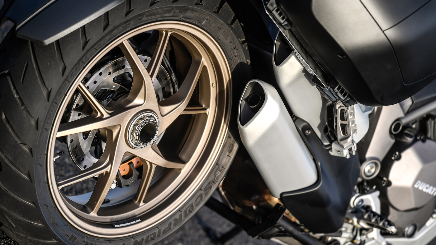 A detail of the back wheel and exhaust of the Ducati Multistrada 1260S.