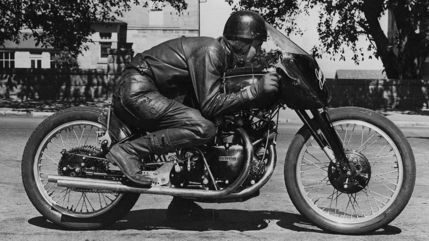 Jack Ehret demonstrates his riding position during the record-breaking run on his Vincent Black Lightning.