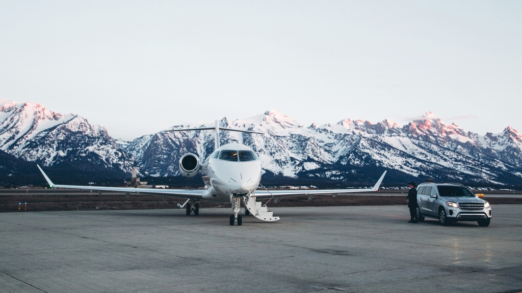 Private jet in front of snowy mountains