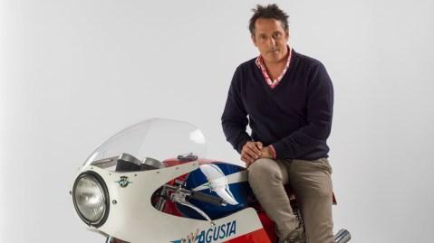 Motorcycle collector Stuart Parr atop his 1971 MV Agusta 750 S.