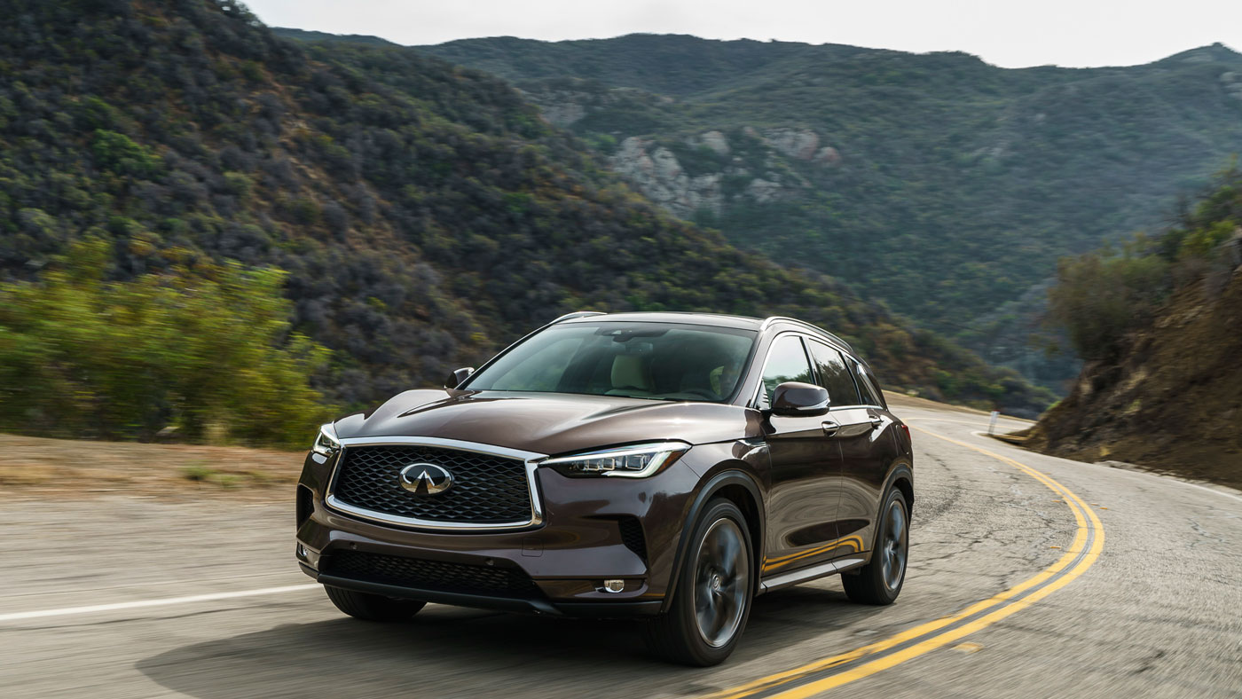 The 2019 Infiniti QX50 driving on a mountain road.