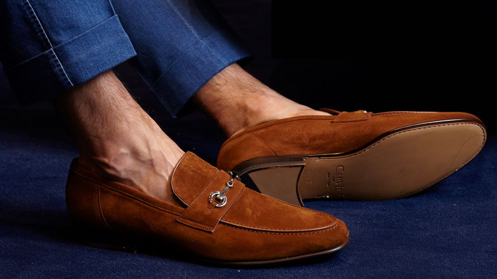 Brown loafers by Carvil brand.
