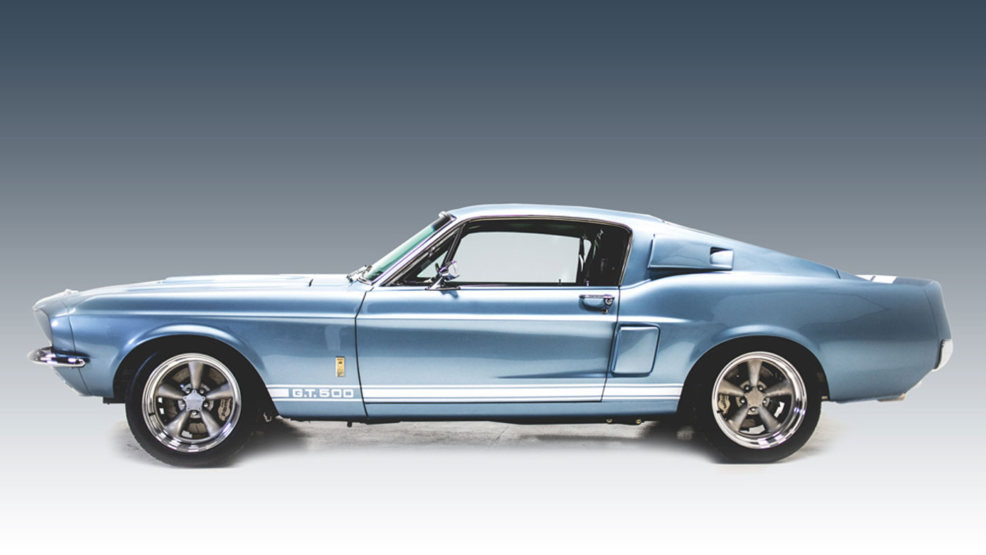 Side view of the Revology 1967 Shelby GT500.