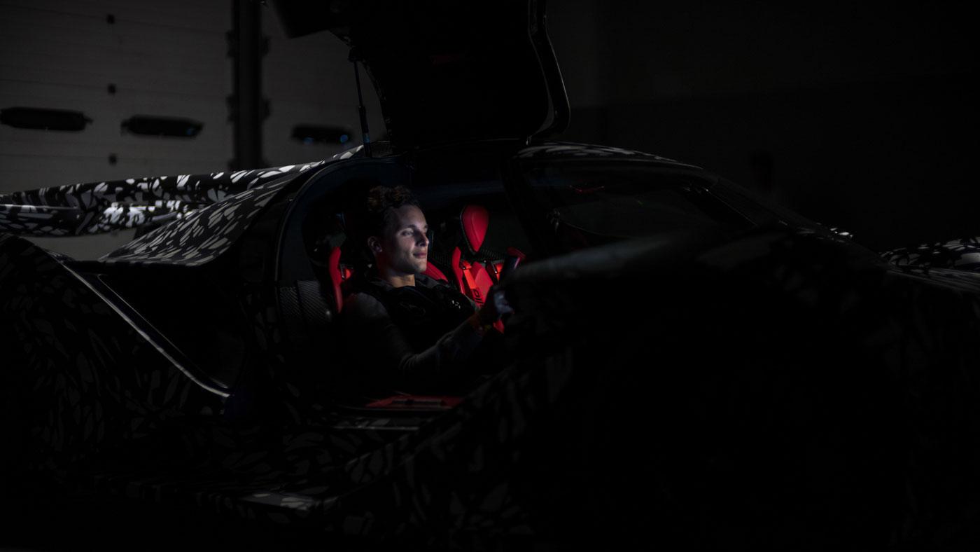 Ryan Berris sitting inside the Apollo Intensa Emozione supercar.