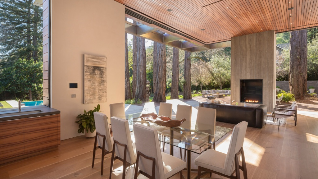 dining room and living room open to backyard