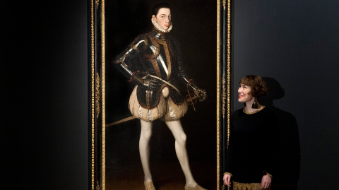 Jonquil O'Reilly of Christie's with a portrait of Alessandro Farnese in Armor (1561).