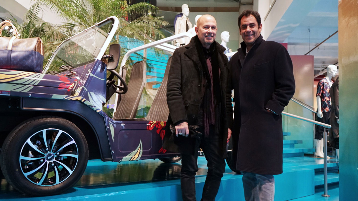 Todd Rome (right) and John Varvatos (left) in front of a Moke America vehicle.