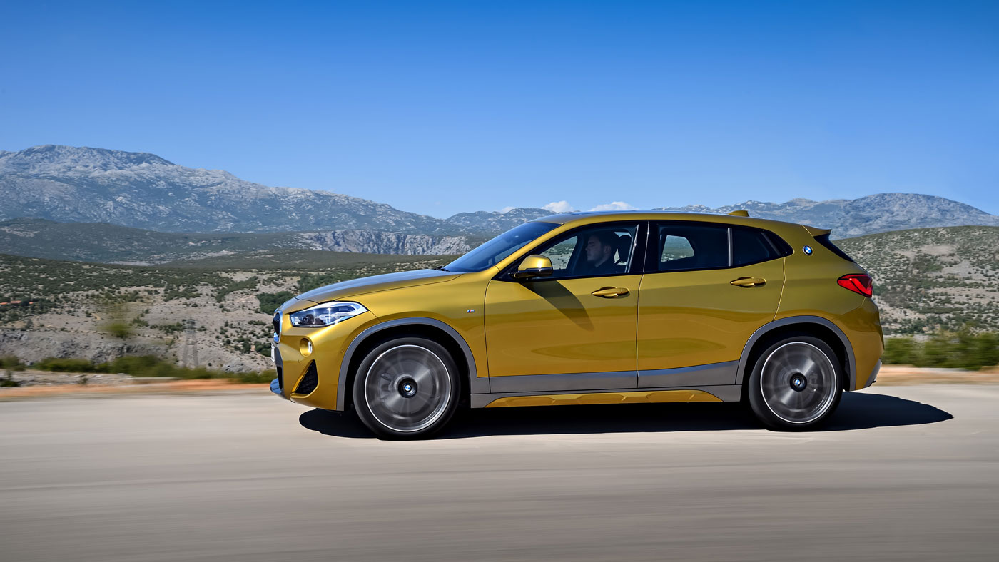 The BMW X2 on a rural road.