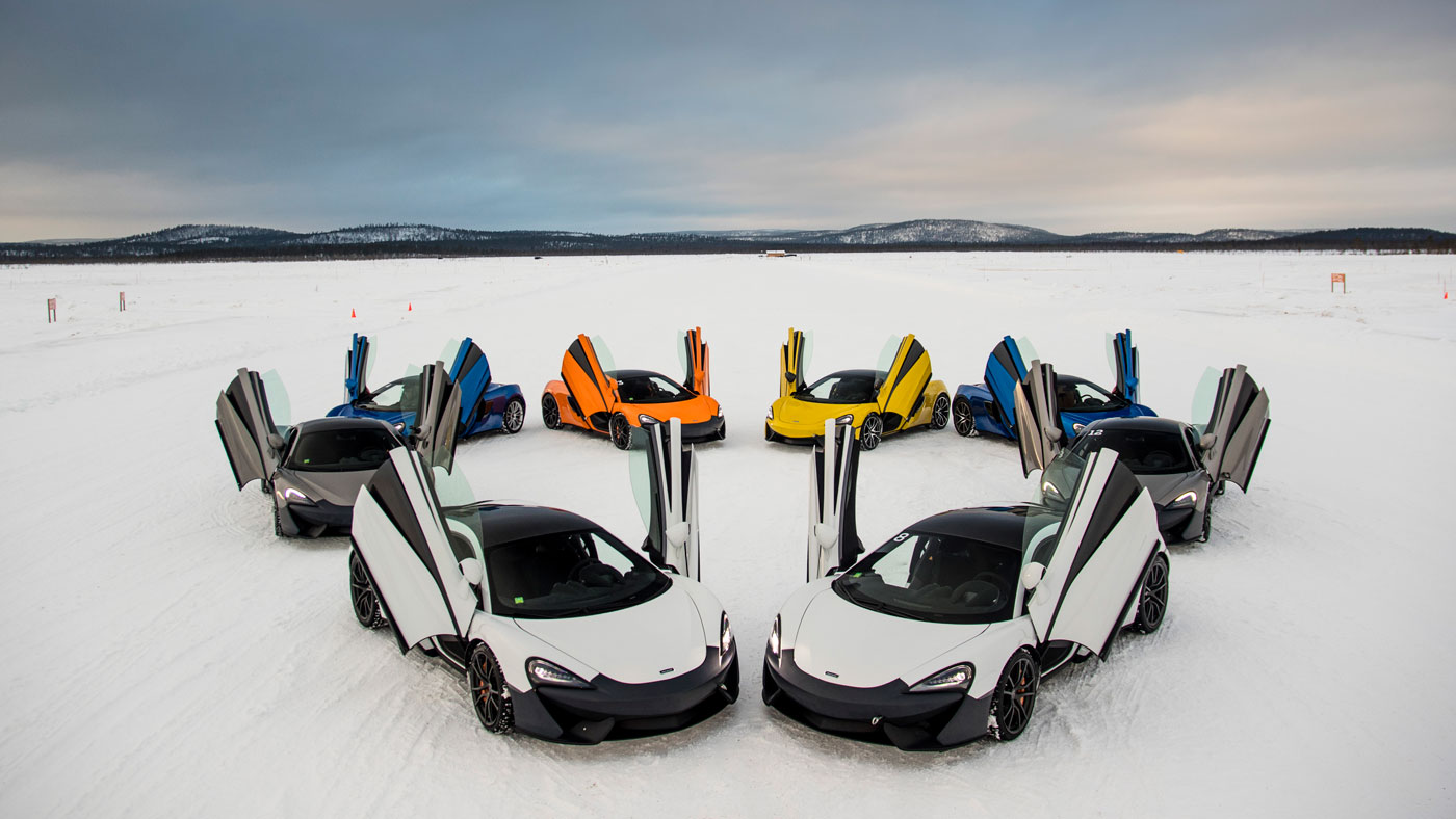 a circle of McLaren 570S Spiders on a frozen lake in Finland.