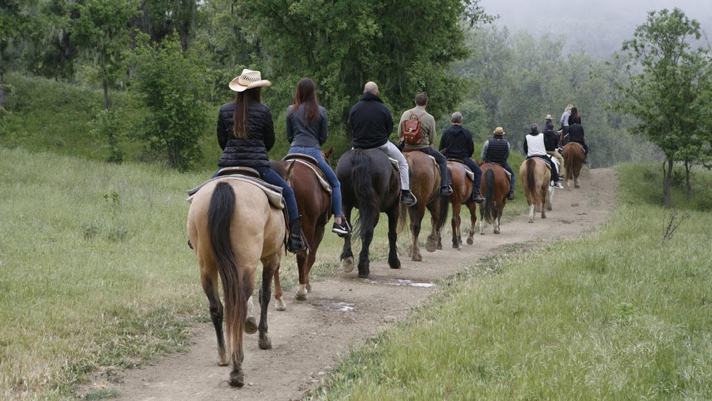 Horseback riding to breakfast at Alisal Guest Ranch & Resort.
