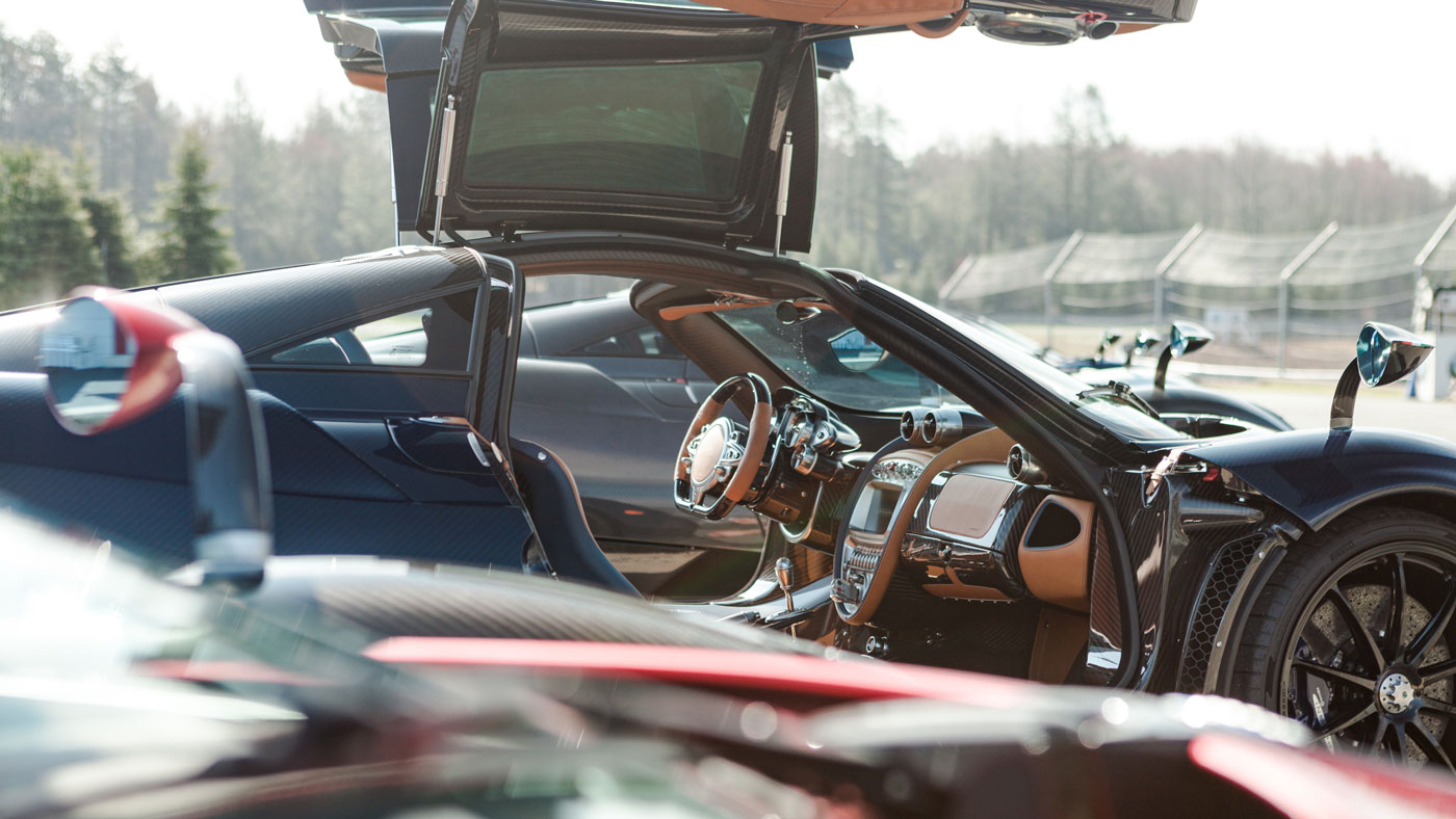 A Pagani Huayra Roadster with its doors open.
