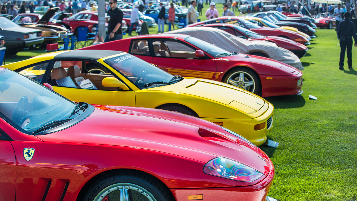 A line of Ferraris at the Quail, a Motorsports Gathering.