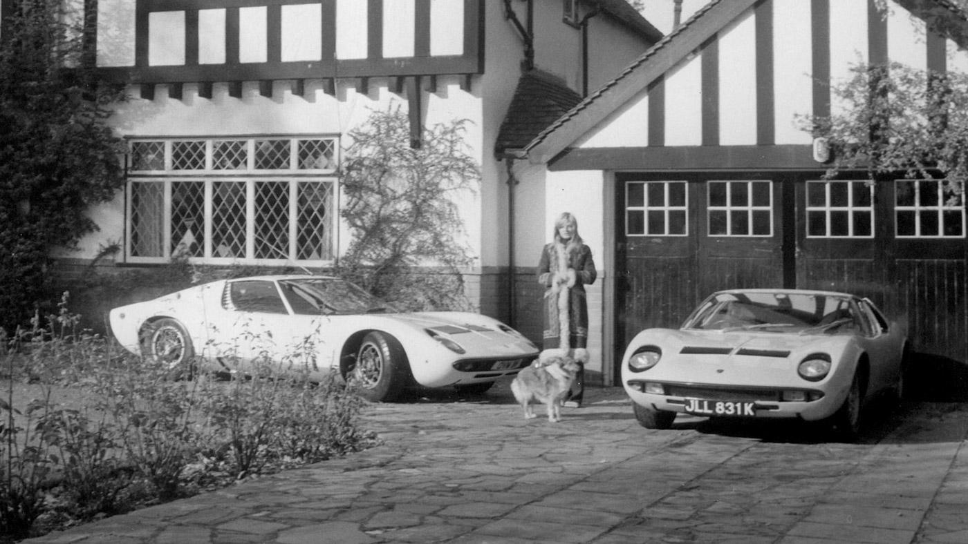 Rod Stewart's former girlfriend, model Dee Harrington, standing with his two Lamborghini Miuras.
