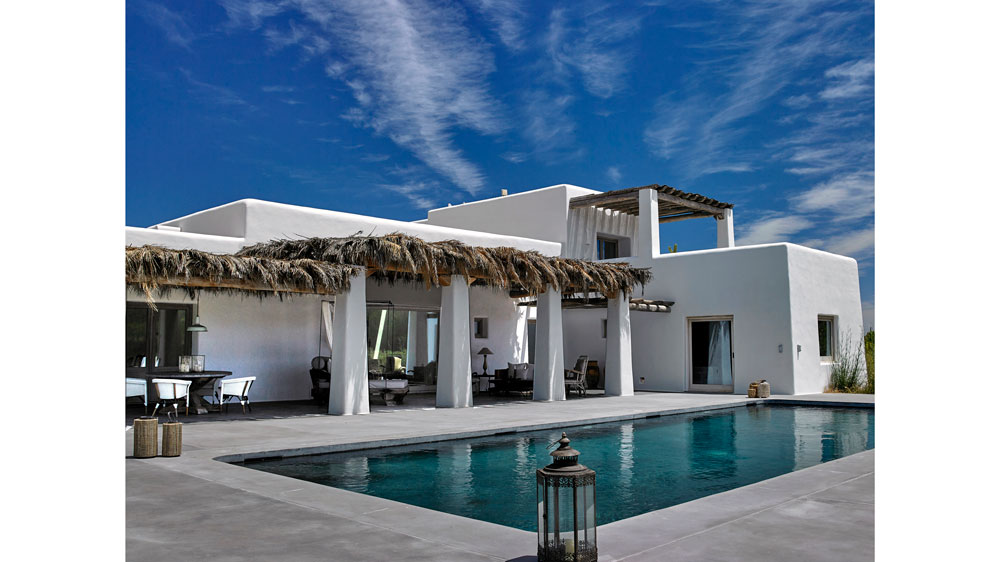 White modern home with pool
