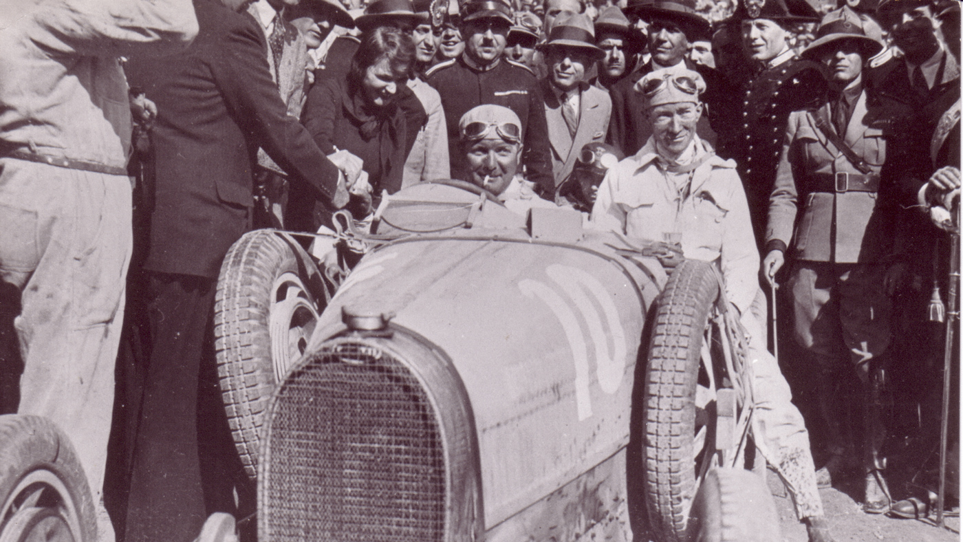 Albert Divo (left) in his Bugatti Type 35 after the winning the Targa Florio in 1929.