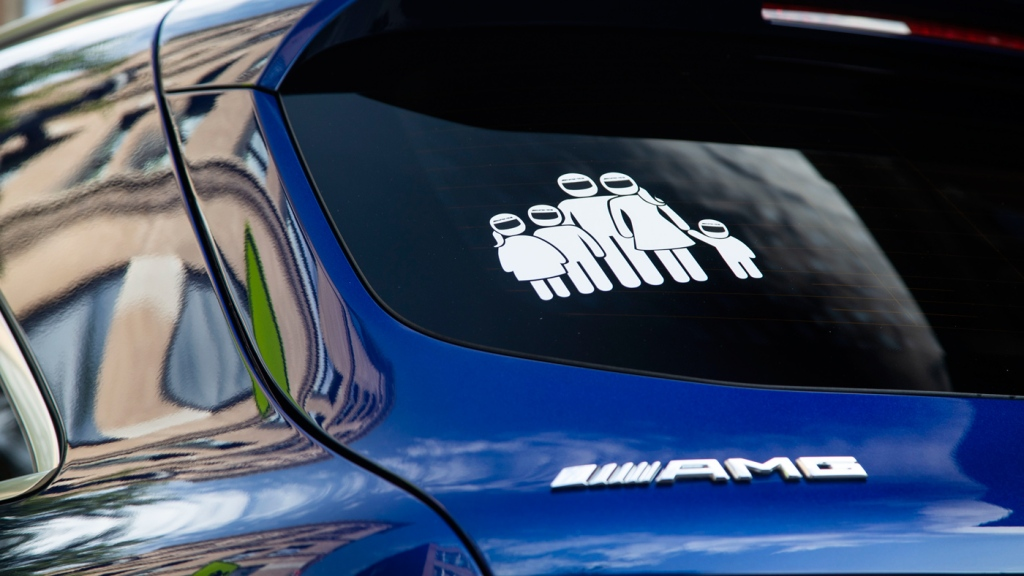 Decal of family in helmets on tha back of a Mercedes-AMG 63 model.