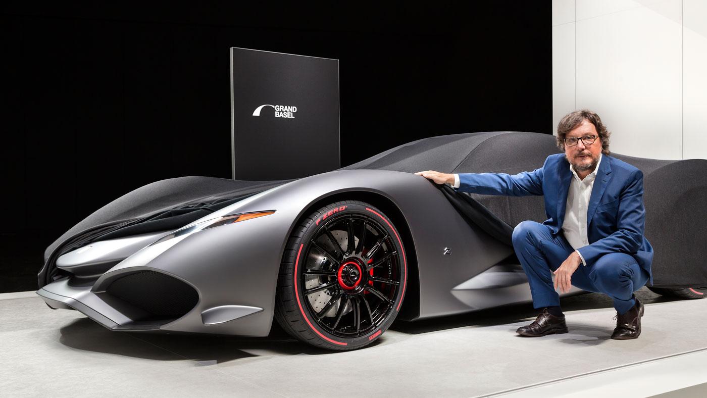 Andrea Zagato beside the Zagato IsoRivolta Vision Gran Turismo concept displayed at a Grand Basel media presentation.