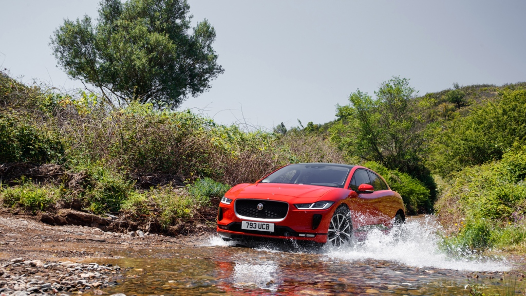 The 2019 Jaguar I-Pace driving through water.