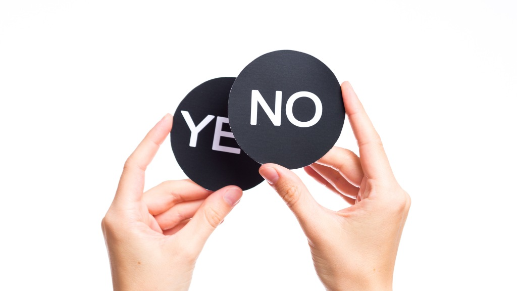 two signs in female fists saying yes and no isolated on a white background. ; Shutterstock ID 204026122; Notes: Muse.com