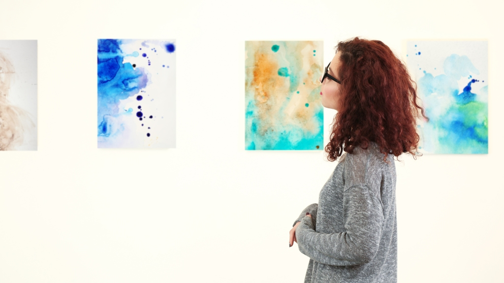 Young woman in modern art gallery; Shutterstock ID 598478111; Notes: Muse.com