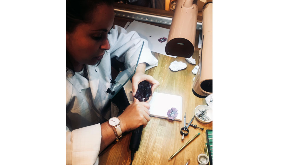 Cartier artisan carves gem