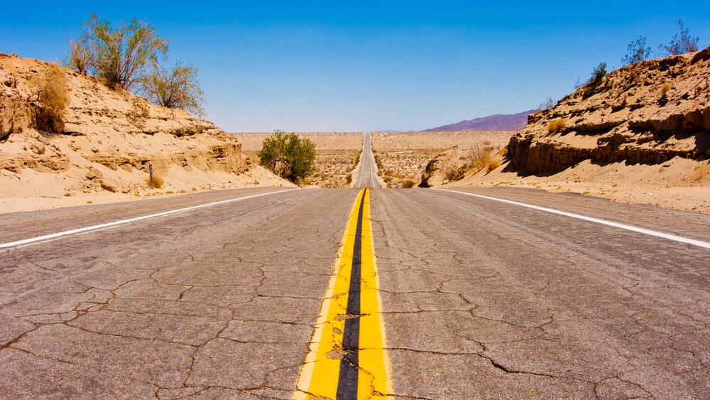 A desolate desert road.