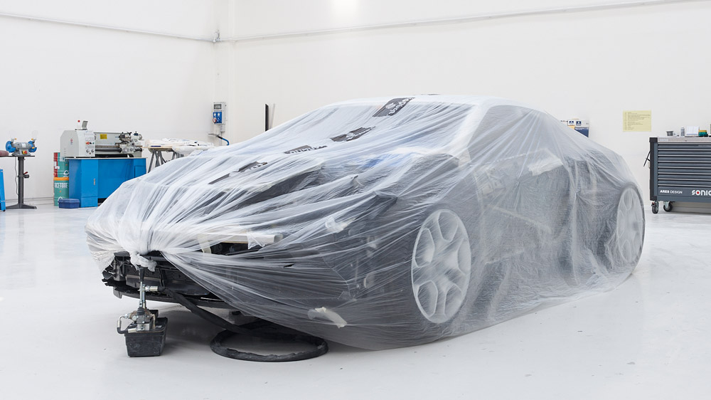 A car under wraps at Ares Design.