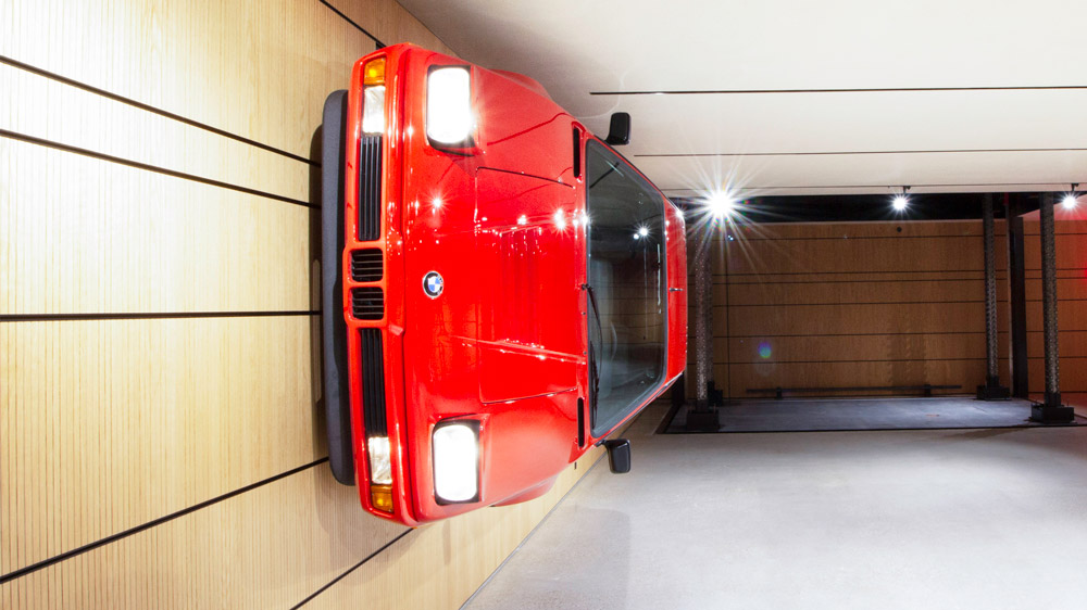 Two BMW M1s joined as wall art.