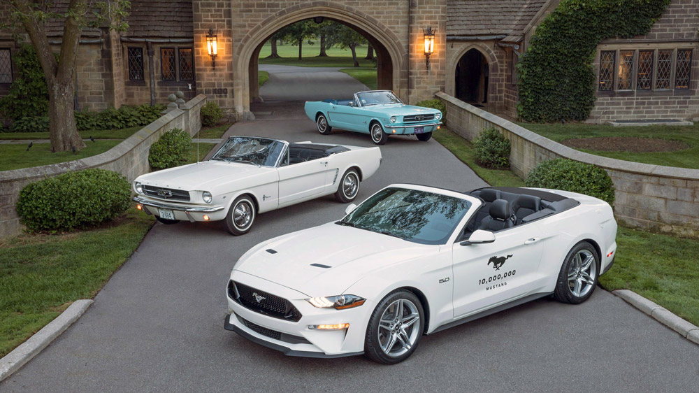 Ford's 10 Millionth Mustang alongside the first one sold.