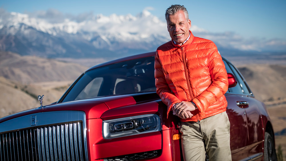 The CEO of Rolls-Royce by the Rolls-Royce Cullinan.