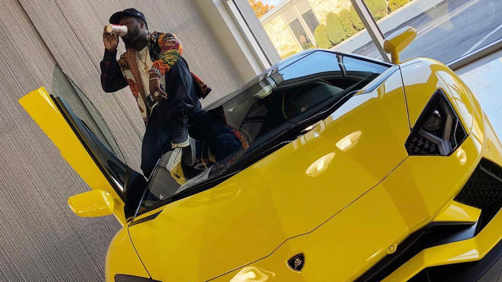 50 Cent and his new Lamborghini Aventador S.