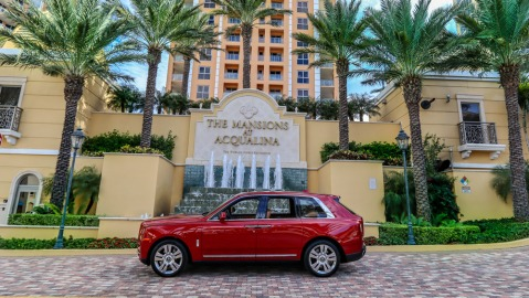 A Rolls-Royce Cullinan in front of the Mansions at Acqualina.
