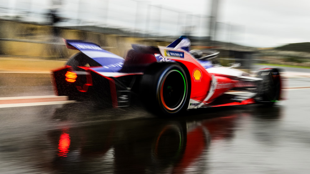 One of Mahindra Racing's Formula E cars takes to the track.