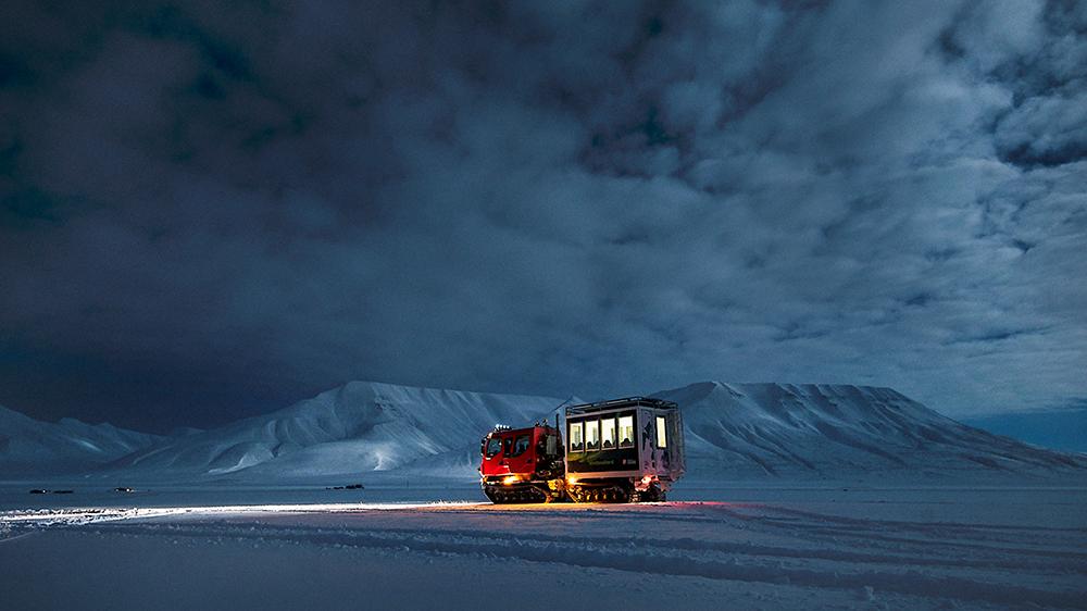 snowcat Svalbard snow