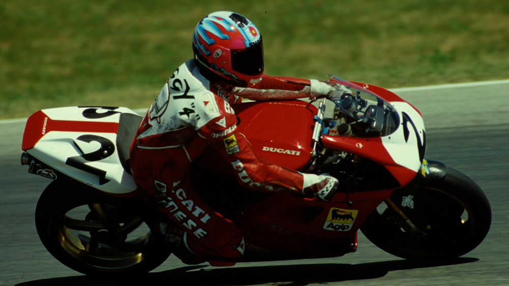 Carl Fogarty racing the Ducati 916 in the 1990s.