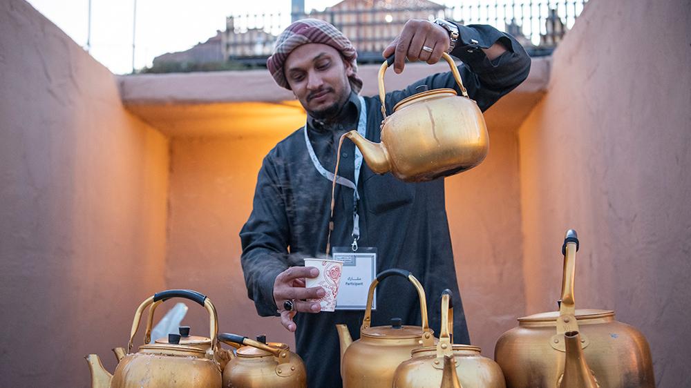 Tantora Festival man pouring tea