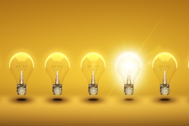 glow among other light bulb on a orange background; Shutterstock ID 105276953; Notes: JeanCase