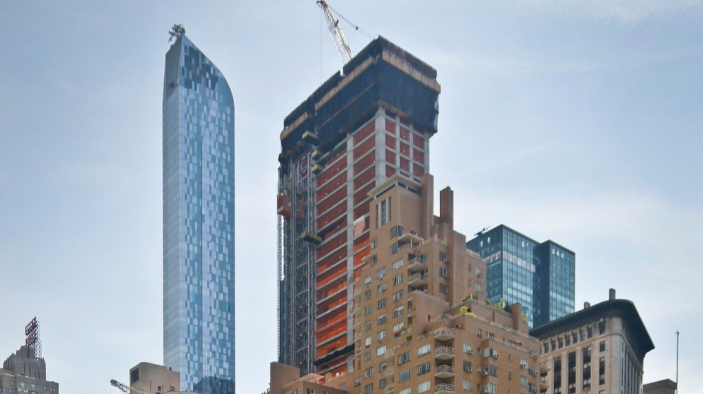 """A luxury 90-floor apartment skyscraper called """"One57,"""" left, rises above all other buildings overlooking Central Park, while a crane sits atop ongoing construction for a new condominium skyscraper at 220 Central Park South, in New York. A penthouse in One57 went for $100.5 million in 2014, but an apartment in the new condominium is expected to sell for $250 millionPriciest NYC Apartment, New York, USA"""