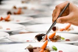 A chef decorates many plates of cake; Shutterstock ID 1093615613; Notes: The World Restaurant Awards